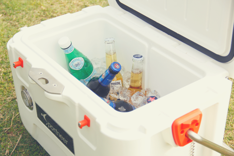 bottled drinks in a white cooler