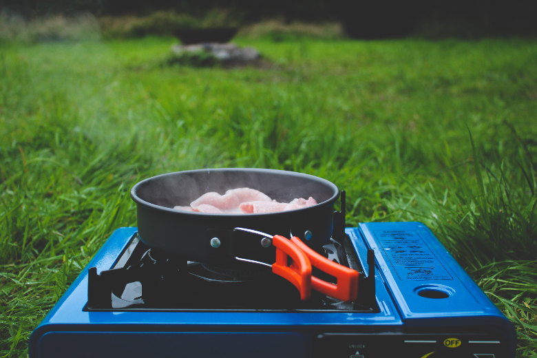 foldable pot heating food on blue camping stove