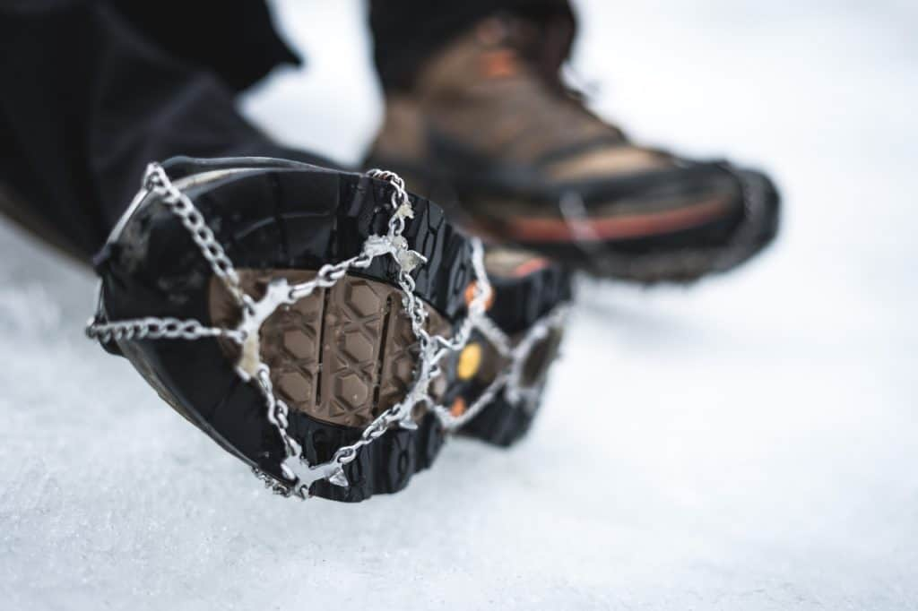 crampons on hiking shoes closeup