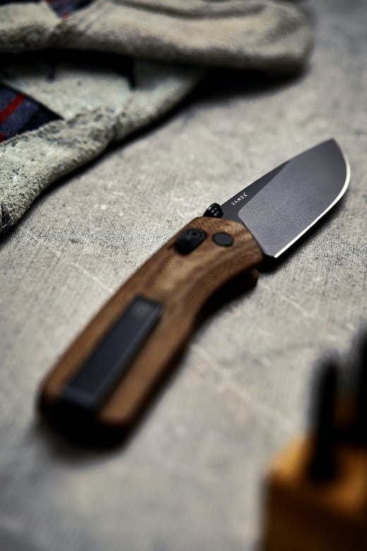 knife with wooden handle lying on cloth